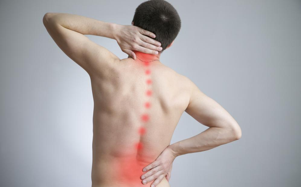 man with back pain before seeing a chiropractor in Clayton
