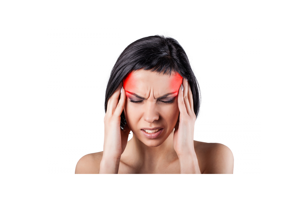 woman with headache or migraine before seeing a chiropractor in Clayton
