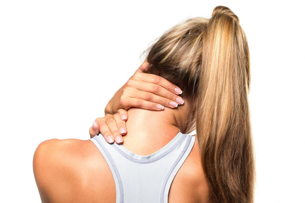 Woman with neck pain before seeing Clayton Chiropractor